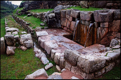 "Tambomachay or Tampumachay (from Quechua: tanpu mach'ay, resting place) is an archaeological site associated with the Inca Empire, located near Cusco, Peru. It is nicknamed ""The Bath of the Inca"".  It consists of a series of aqueducts, canals and waterfalls that run through the terraced rocks. The function of the site is uncertain: it may have served as a military outpost guarding the approaches to Cusco, as a spa resort for the Incan political elite, or both."