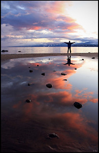 Reflection of Colorful Afterglow and Silhouette, Lake Tahoe, Sunset