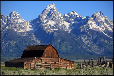 John Moulton Barn and the Tetons, Early Morning, Grand Teton National Park  Moulton Barn is perhaps one of Jackson Hole's most photographed scenes: A weathered barn in a green meadow rises up against the Tetons. The barn is part of the Mormon settlement now called Mormon Row, still stands intact in all of its rustic glory. The barn has become an icon of the Old West, weathered almost a century and still standing today.